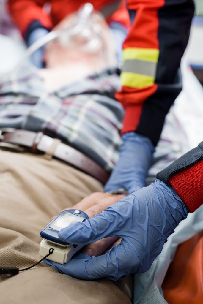 First responders treat injured victim at scene