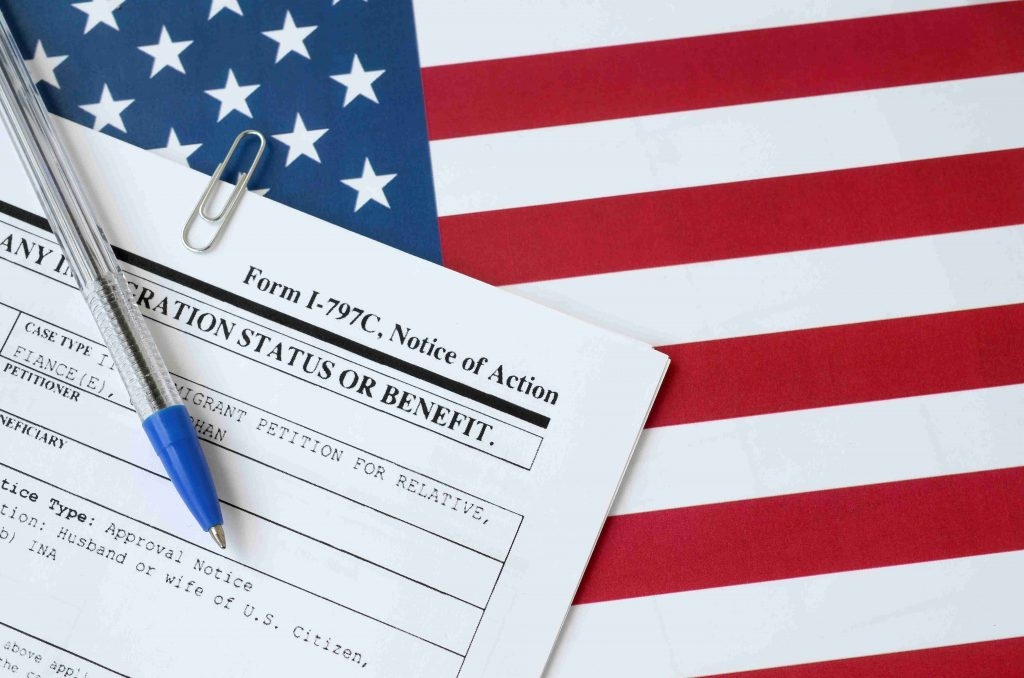 Immigration Form and U.S. Flag