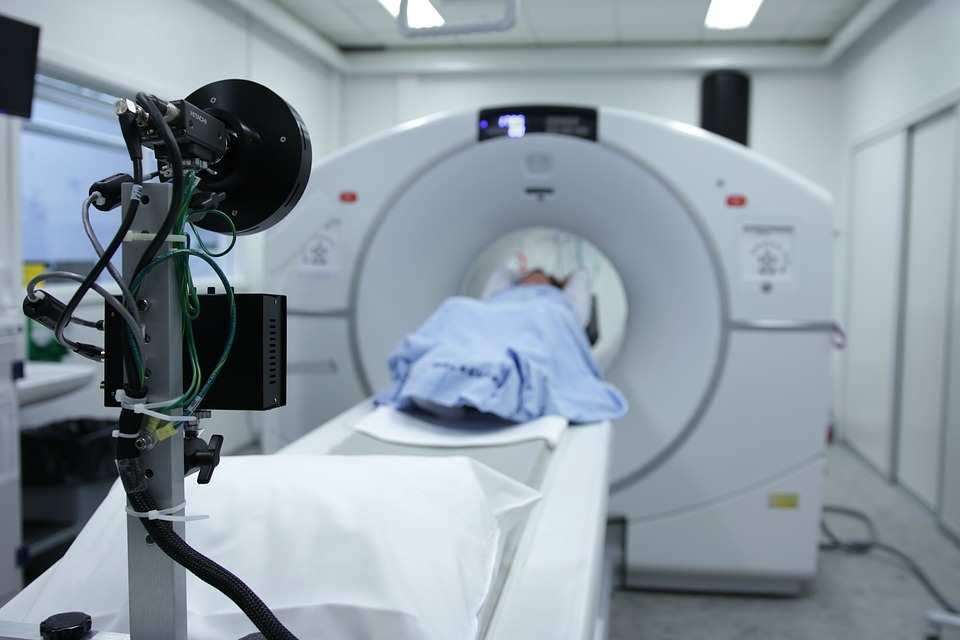 car accident patient in CT scan machine