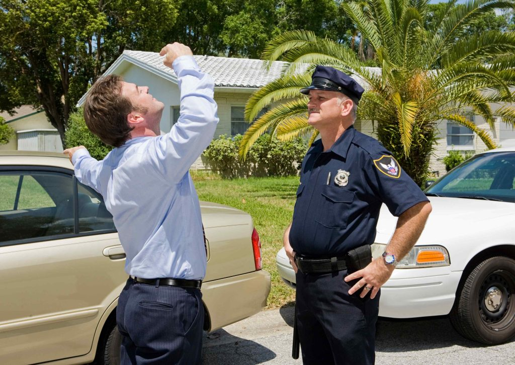 man participating in field sobriety test after being stopped for drunk driving